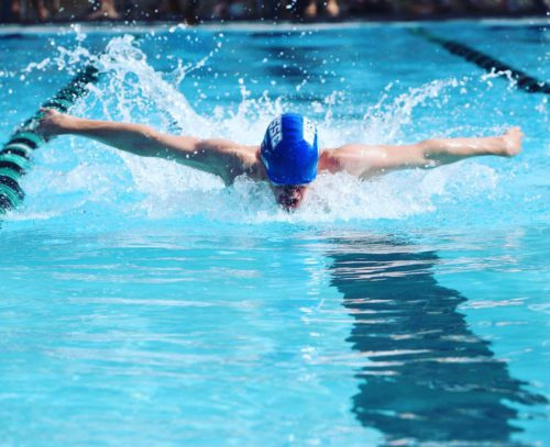 West Side swimmer competing in the butterfly