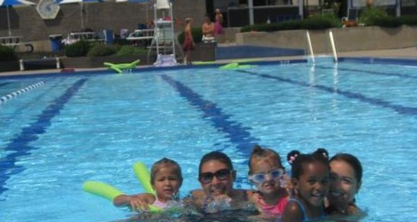 Swim lesson instructors and participants in the pool